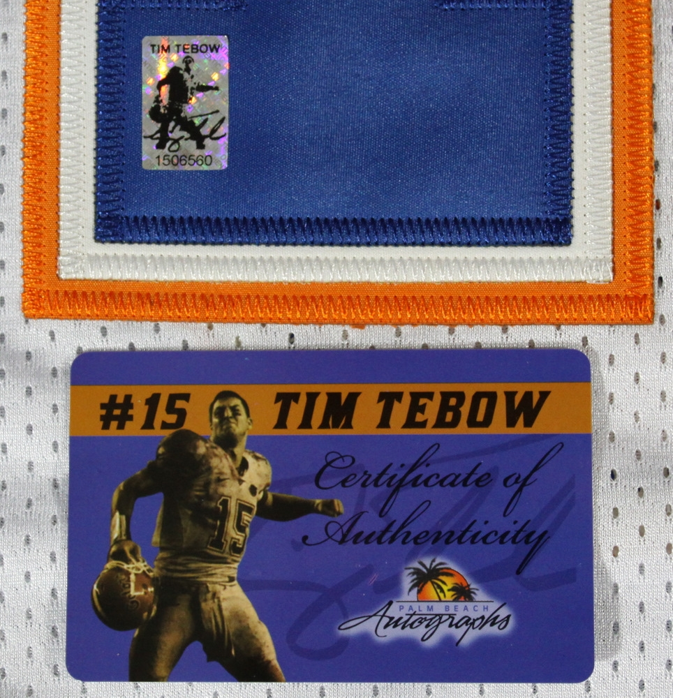 Florida ID Hologram https://pristineauction.com/auctions/index/details/id/5744/Tim-Tebow-Signed-Florida-Gators-Jersey-(Tebow-Hologram-&-COA)