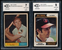 Lot of (2) Brooks Robinson Graded Baseball Cards with 1961 Topps #10 (BCCG 7) & 1974 Topps #160 (BCCG 9) at PristineAuction.com